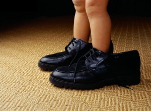 Toddler Standing in Father's Shoes